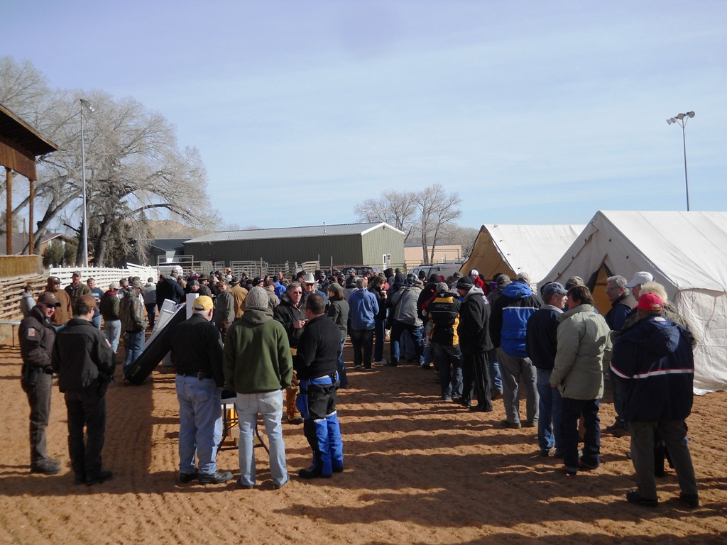 Crowd shot of people waiting in line for free samples of cooked burbot during the closing ceremonies of the 2012 Burbot Bash