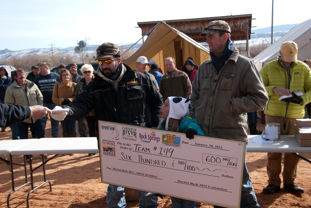 Photo of Team Asay as they are awarded their winnings for the Most Burbot during the 2012 Burbot Bash.