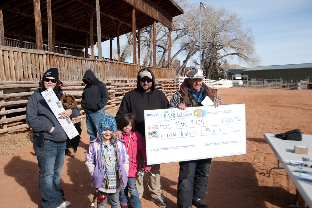 Photo of the winners of the tagged fish drawing accept their check at closing ceremonies of the 2012 Burbot Bash