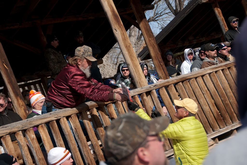Drawing prize winner receives his prize during the closing ceremonies of the 2012 Burbot Bash