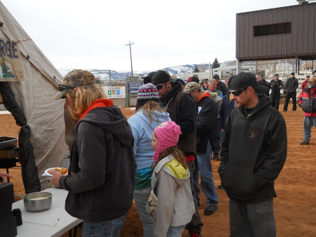 Photo of participants and family members lined up to enjoy samples of burbot prepared by the Flaming Gorge Resort during the closing cermenies of the 2013 Burbot Bash.