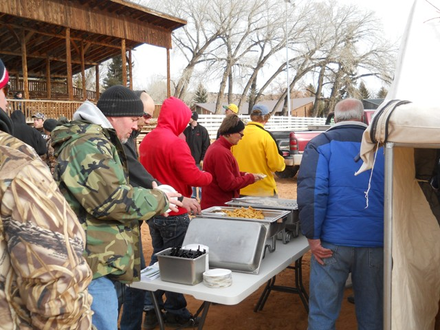 Photo of participants and family members lined up to enjoy samples of burbot prepared by the Flaming Gorge Resort during the 2013 Burbot Bash.