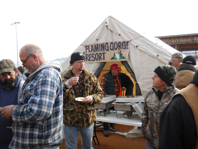 Photo of people eating Burbot prepared during 2013 Burbot Bash Closing Ceremonies