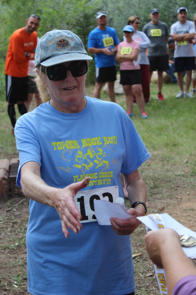 Photo of an age group winner receiving her award for the Tower Rock Run 5k