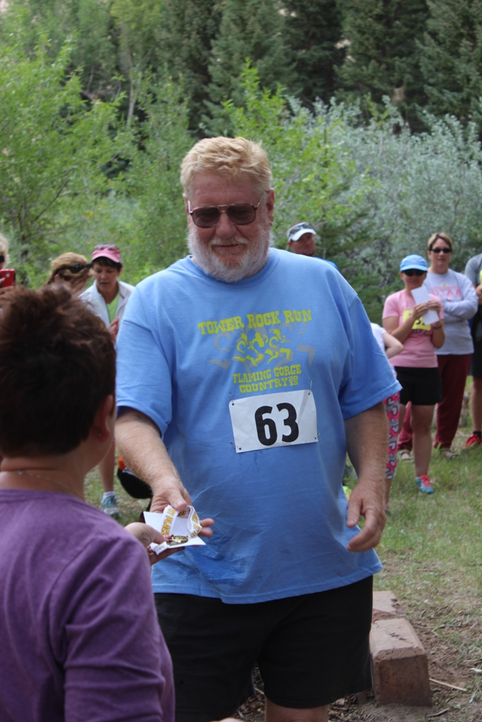 Photo of an age group winner receiving his award for the Tower Rock Run 5k
