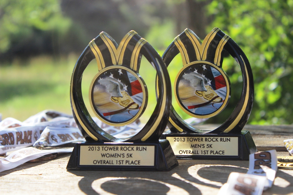 Photo of the 5k trophies for top Male and Female runners for the 2013 Tower Rock Run