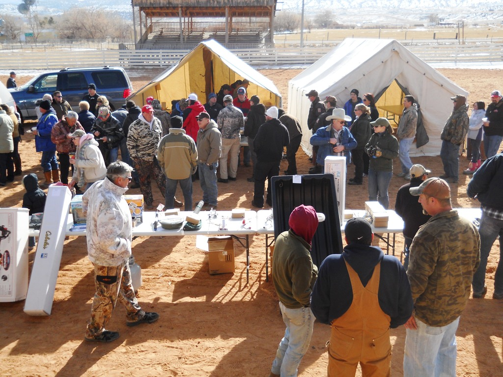 Crowd shot of people browzing the prize table and standing in line to get free samples of cooked burbot during the closing ceremonies of the 2012 Burbot Bash