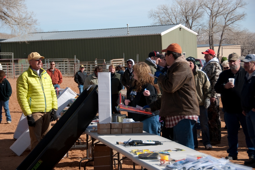 Photo of Adam Eakle calling out the next drawing winner during the closing ceremonies of the 2012 Burbot Bash