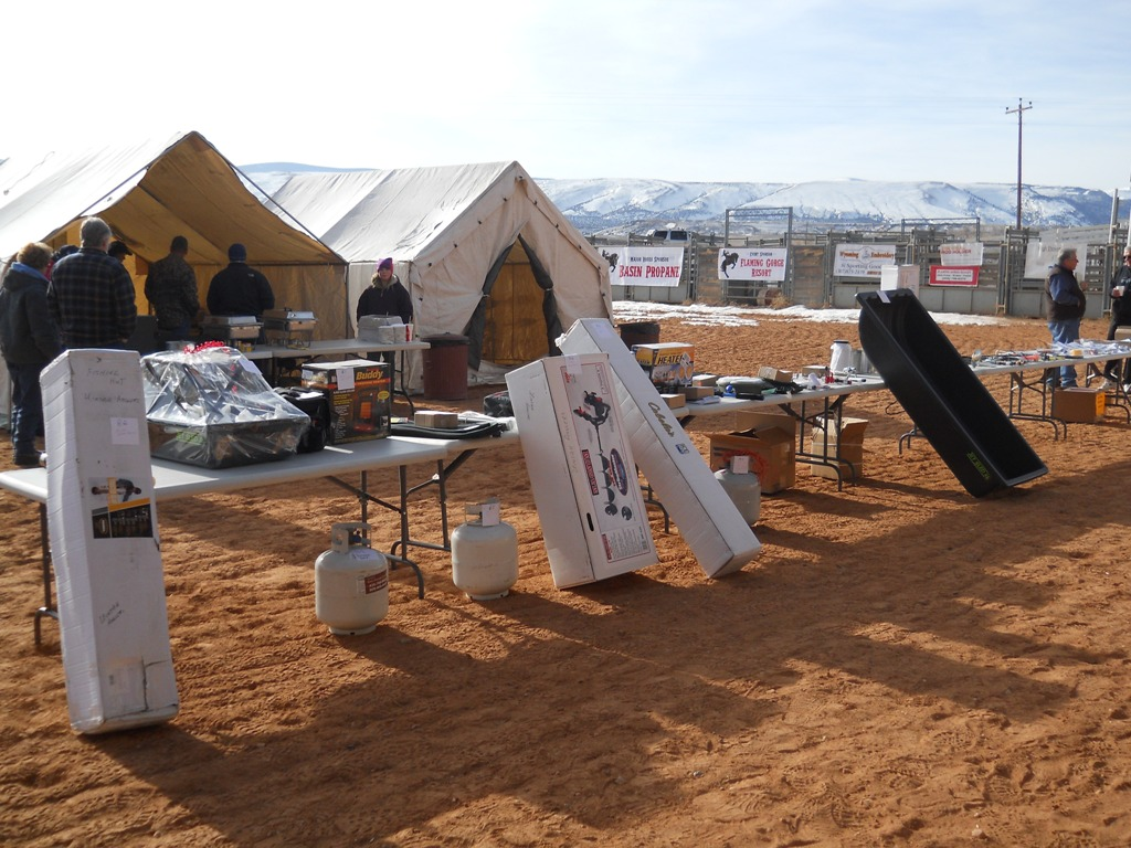 Photo of prize tables stacked with prizes to give away during the closing ceremonies of the 2012 Burbot Bash