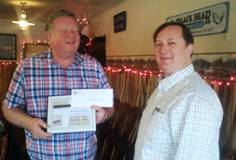 Al Browning receives his award and gift certificate as the recipient of the 2012 Spirit of Falming Gorge - Business Award.